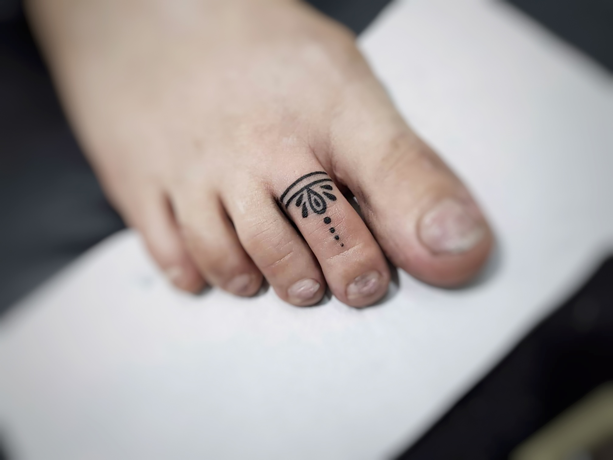Toe ring tattoo, minimal tattoo by sumina shrestha- best female tattoo artist in nepal